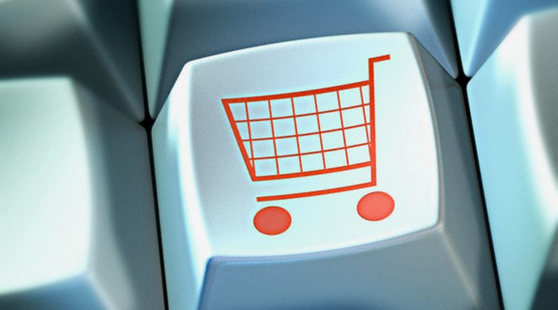 Shopping Cart on Computer Keyboard Button --- Image by © Matthias Kulka/zefa/Corbis