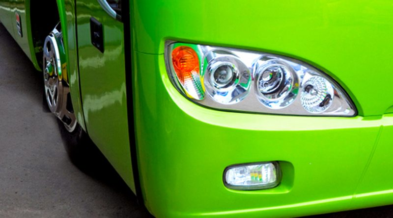 green bus headlight